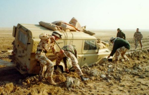 A mired Land Rover of the 1st Armoured Division being extracted during the Gulf War